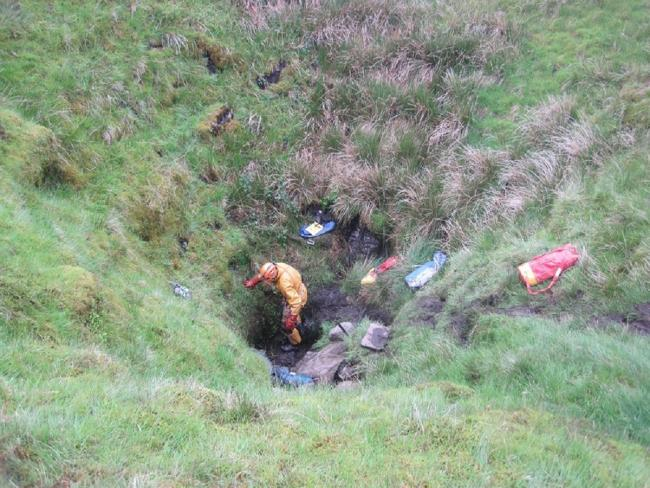 A rescuer at the mouth of Curtain Pot. Picture: Swaledale MRT