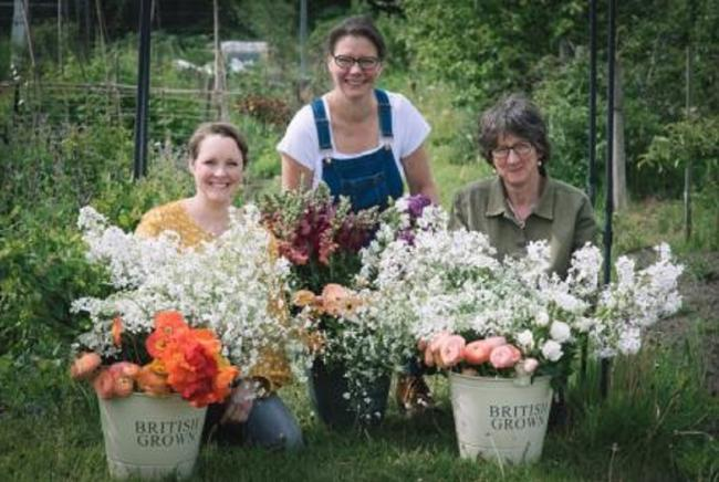 Jane Tucker, Susanne Loweth and Claire Clark with their flowers. Picture: Tiffany Photography