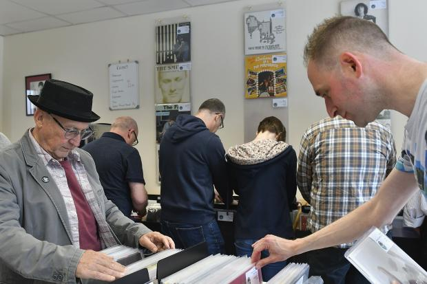Bradford Telegraph and Argus: Vinyl fans check out the stock at Five Rise Records, Bingley