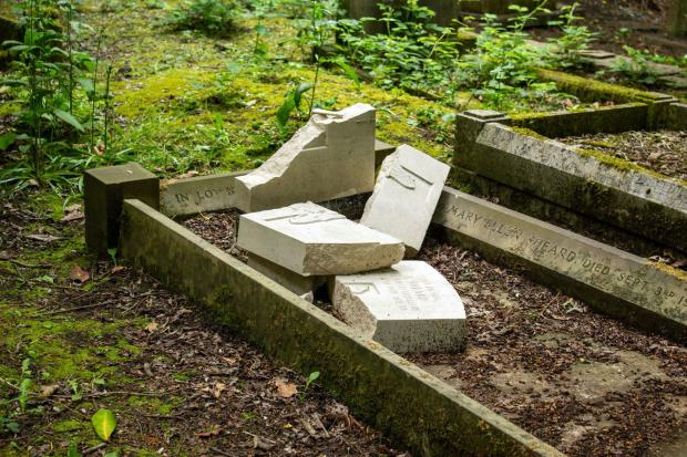 Bradford Telegraph and Argus: One of the damaged graves at Hirst Wood burial ground