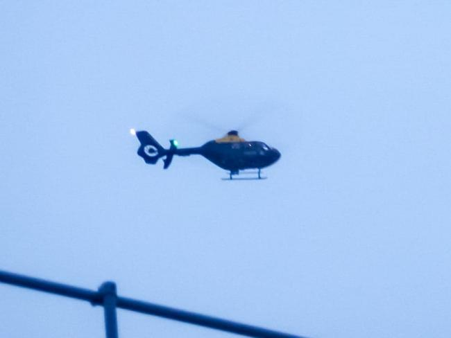 The police helicopter on the scene in Keighley last night Picture: Philip Roger Bailey