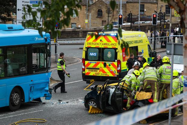 Bradford Telegraph and Argus: Fire and ambulance crews work at the scene