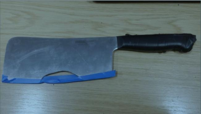 Man had meat cleaver in street